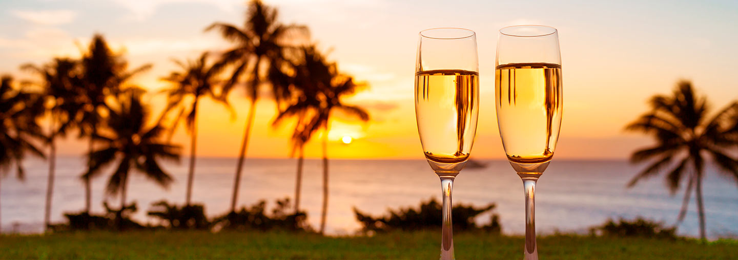 Champagne glasses with a sunset