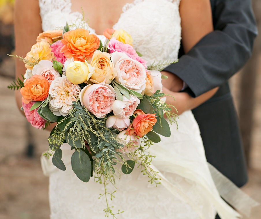 Wedding Couple With Floral Bouquet