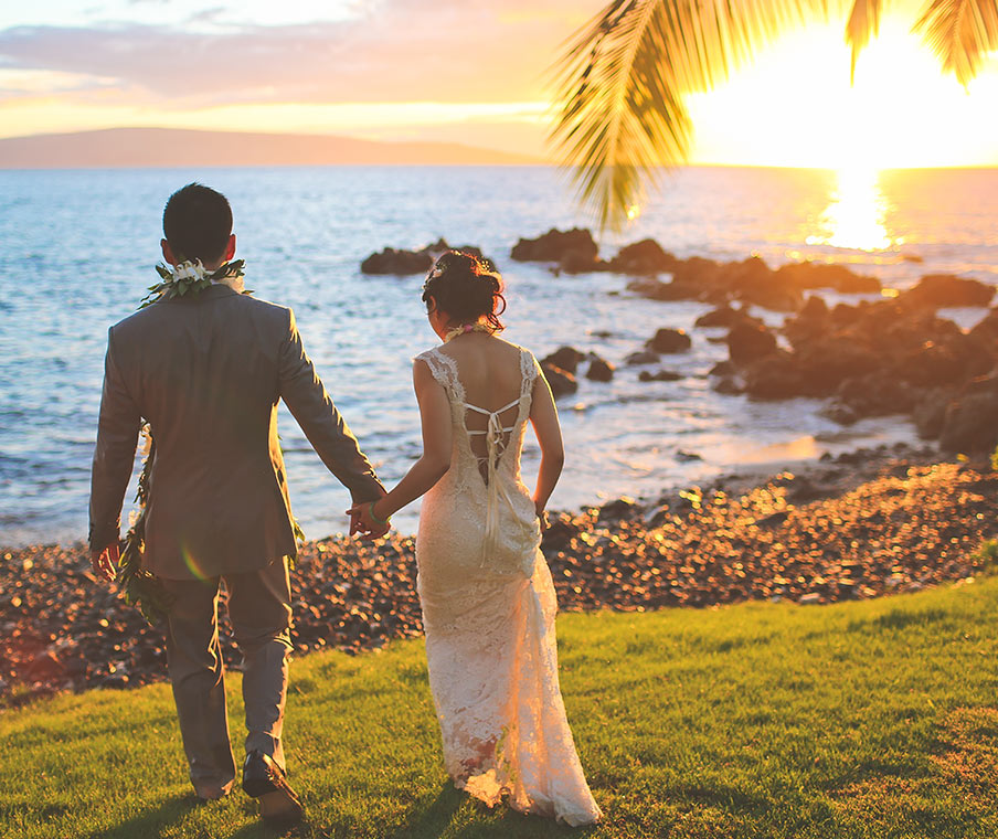 Couple holding hands after being just married in Hawaii